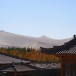 View of the Dunhuang dunes from our hotel roof. Intrepid, us