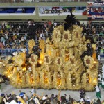 One of the many crazy floats, loaded high with boogying performers hanging on for dear life