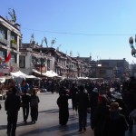 Street scene in the old town. Tibetans walking clockwise (of course); Chinese walking anti clockwise (of course)