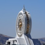 A huge gold and white marble ferris wheel. In the desert. Of course